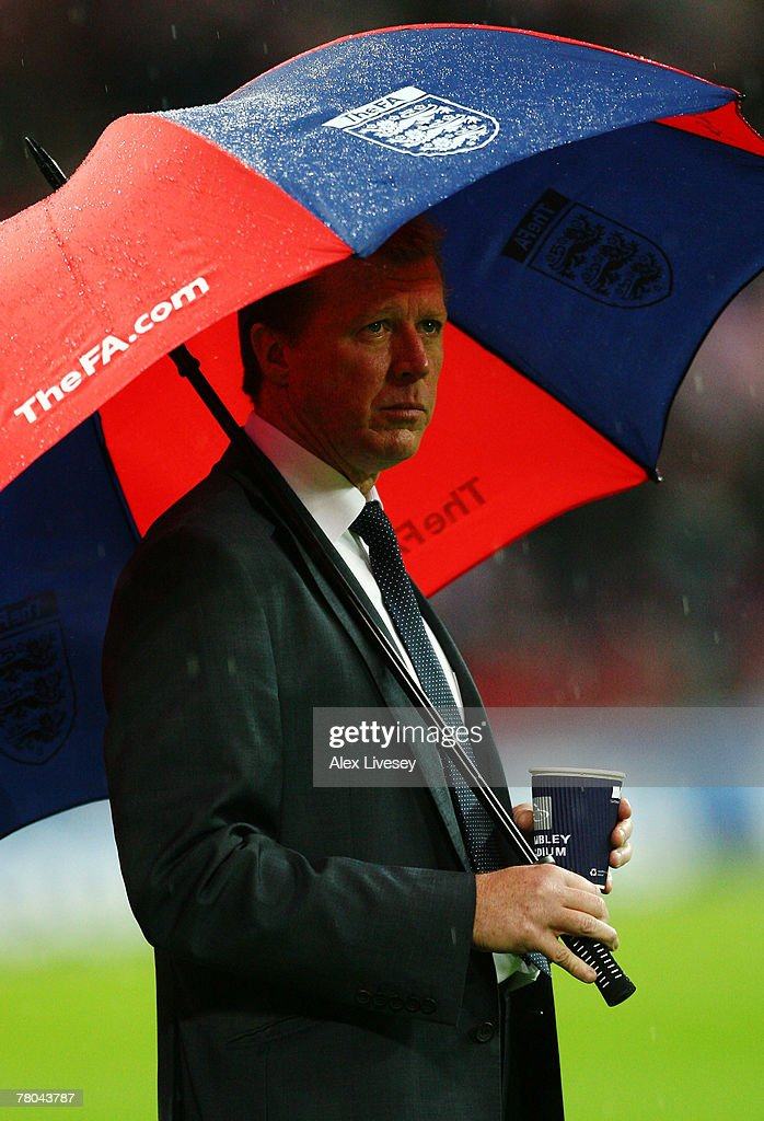 Steve McClaren manager of England looks on from under his umbrella prior to the Euro 2008 Group E qualifying match between England and Croatia at Wembley Stadium on November 21, 2007 in London, England.