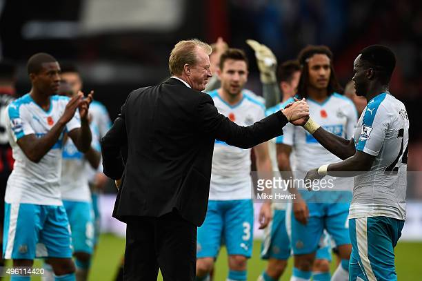 Steve McClaren manager of Newcastle United shakes hands with Cheik Ismael Tiote to celebrate their 10 win in the Barclays Premier League match...