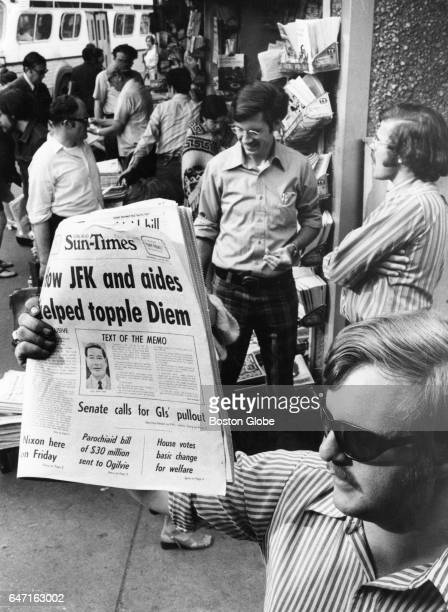 Steve McGrath of Reading holds up a copy of the Chicago SunTimes for sale at the Out of Town News stand in Cambridge MA's Harvard Square on Jun 23...