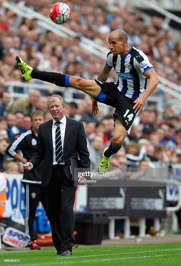 Steve McLaren manager of Newcastle United looks on as Gabriel Obertan of Newcastle United jumps for the ballduring the Barclays Premier League match between Newcastle United and Southampton at St James Park on August 9, 2015 in Newcastle, England.