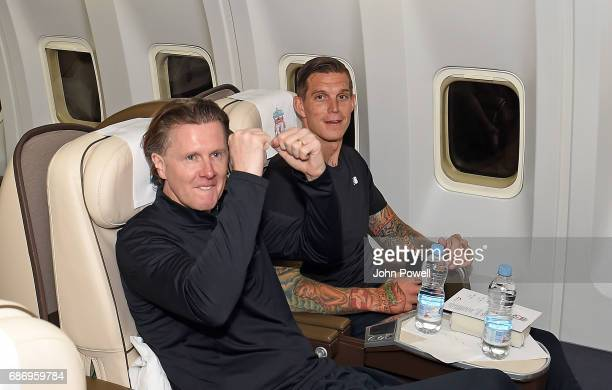 Steve Mcmanaman and Daniel Agger ex players of Liverpool on the plane to Australia at Melwood Training Ground on May 22 2017 in Liverpool England
