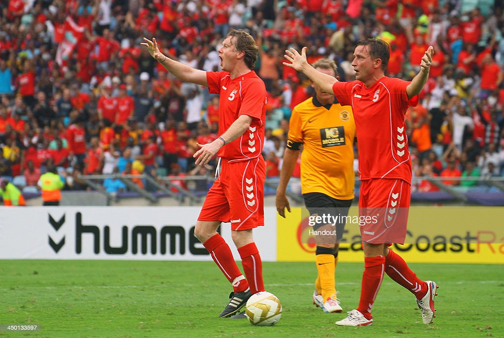 Steve McManaman and Vladimir Smicer appeal to the touch judges during the Legends match between Liverpool FC Legends and Kaizer Chiefs Legends at Moses Mabhida Stadium on November 16, 2013 in Durban, South Africa.
