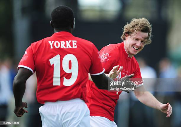 Steve McManaman celebrates with Dwight Yorke during the Laureus Football Challenge presented by IWC Schaffhausen as part of the 2011 Laureus World...