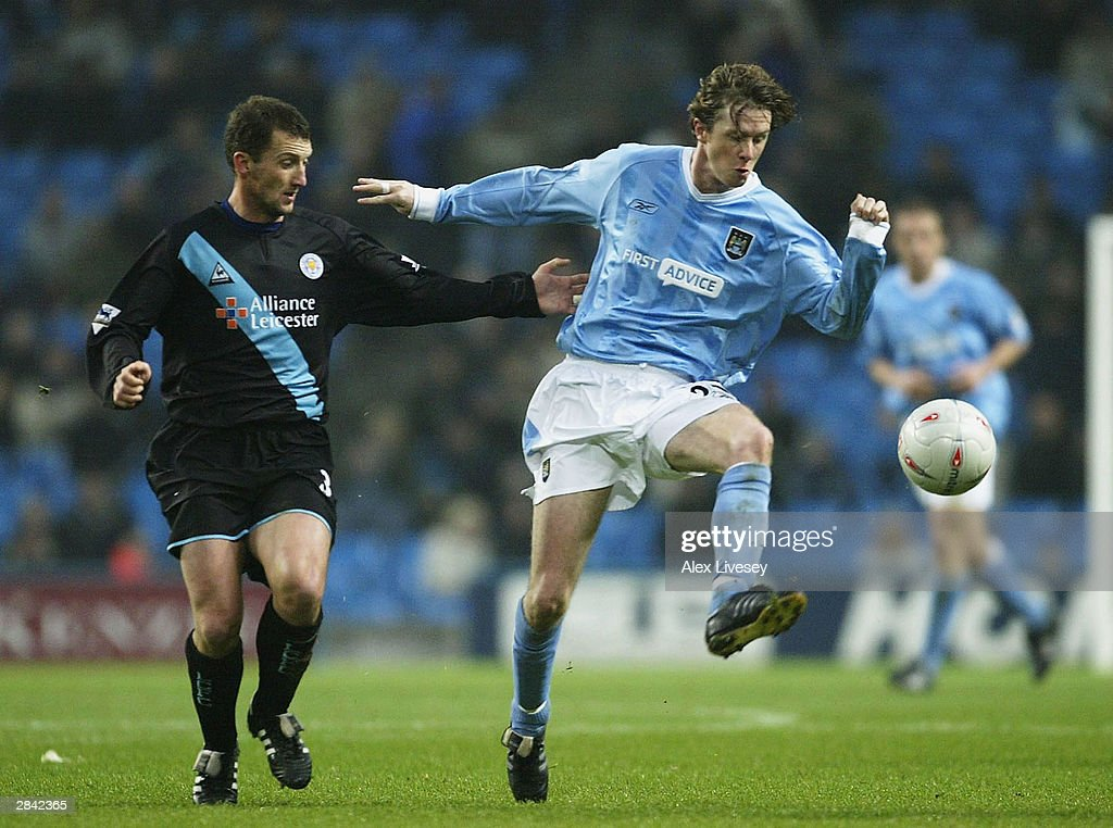 Steve McManaman of Manchester City beats Billy McKinlay of Leicester City during the FA Cup third round match between Manchester City and Leicester City at City of Manchester Stadium on January 3, 2004 in Manchester, England.