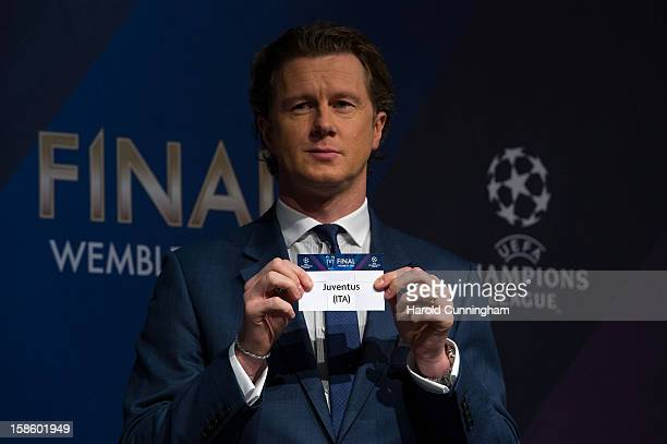 Steve McManaman UEFA Champions League Final Ambassador shows the name Juventus during the draw for the last 16 of the UEFA Champions League at the...