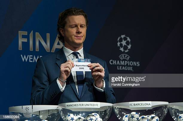Steve McManaman UEFA Champions League Final Ambassador shows the name Bayern Munich during the draw for the last 16 of the UEFA Champions League at...