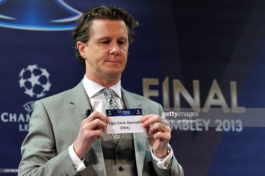 Steve McManaman, UEFA Champions League Final Ambassador, shows the name Paris Saint-Germain FC during the UEFA Champions League quarter finals draw at the UEFA headquarters on March 15, 2013 in Nyon, Switzerland.