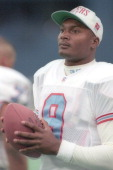 Steve McNair of the Houston Oilers looks on before a football game against the Pittsburgh Steelers on December 3 1995 at Three Rivers Stadium in...