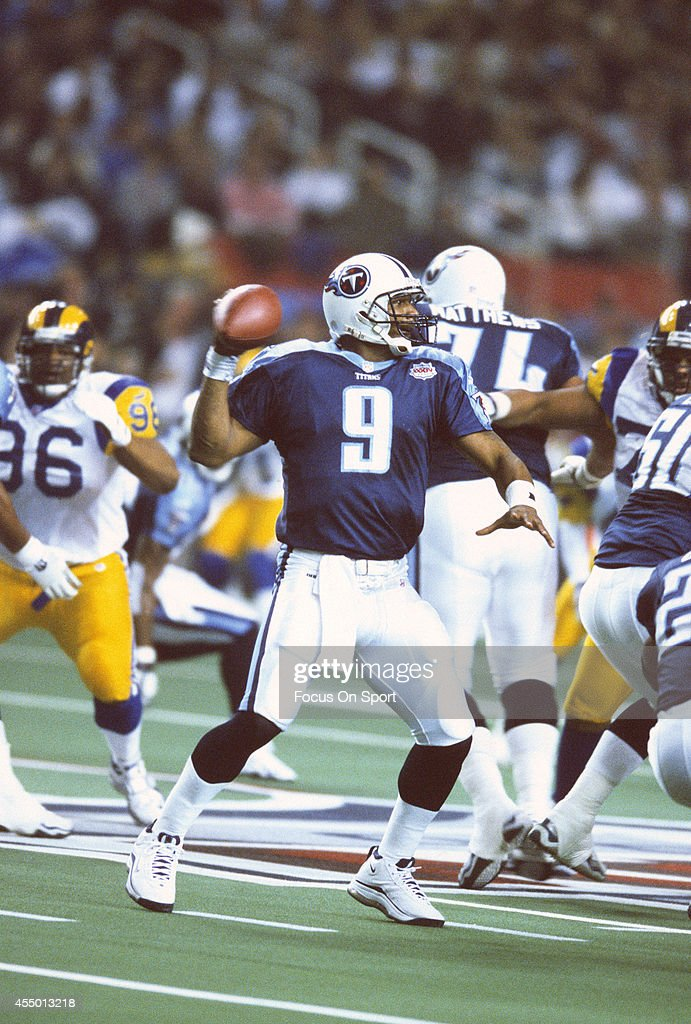Steve McNair of the Tennessee Titans drops back to pass against the St Louis Rams during Super Bowl XXXIV at the Georgia Dome on January 30 2000 in...