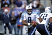 Steve McNair of the Tennessee Titans drops back to pass against the Baltimore Ravens during an NFL football game October 7 2001 at PSINet Stadium in...
