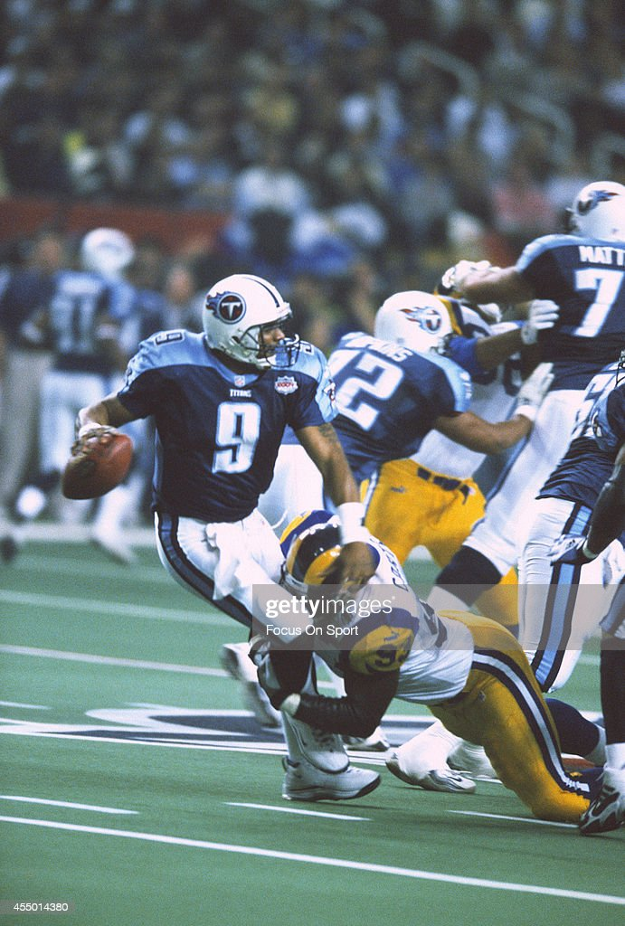 Steve McNair of the Tennessee Titans gets sacked by Kevin Carter of the St Louis Rams during Super Bowl XXXIV at the Georgia Dome on January 30 2000...