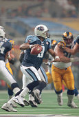 Steve McNair of the Tennessee Titans looks to pass against the St Louis Rams during Super Bowl XXXIV at the Georgia Dome on January 30 2000 in...