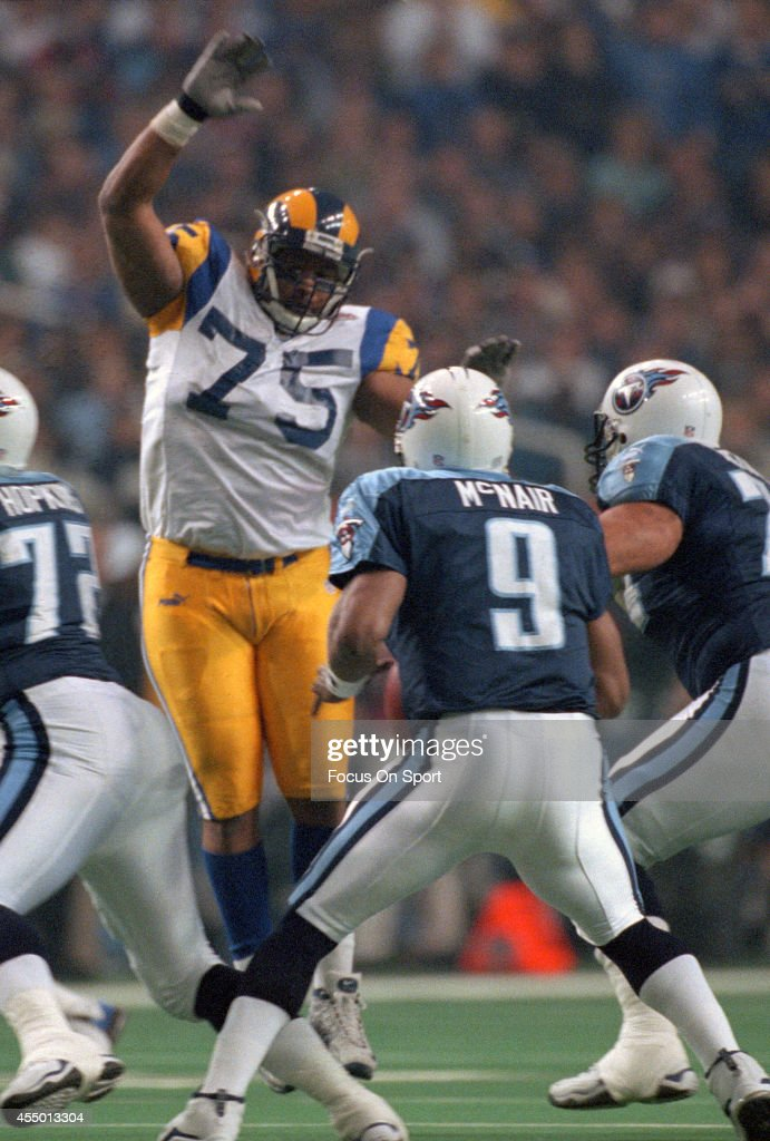 Steve McNair of the Tennessee Titans looks to pass while under pressure from D'Marco Farr of the St Louis Rams during Super Bowl XXXIV at the Georgia...