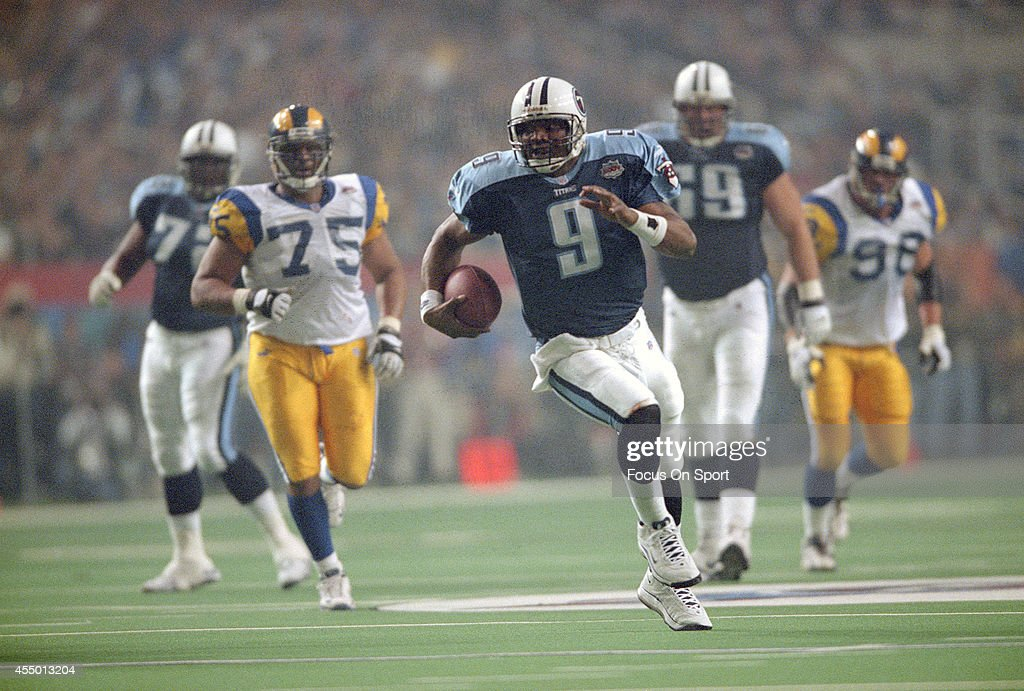 Steve McNair of the Tennessee Titans runs with the ball against the St Louis Rams during Super Bowl XXXIV at the Georgia Dome on January 30 2000 in...