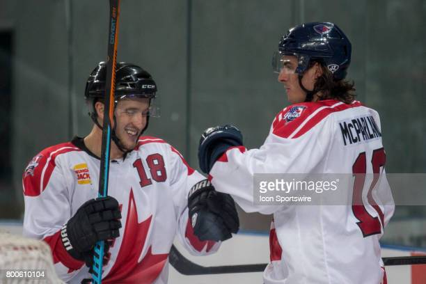 Steve McParland of Team Canada and Adam Hughesman of Team Canada celebrate a Team Canada Goal during the Melbourne Game of the Ice Hockey Classic on...