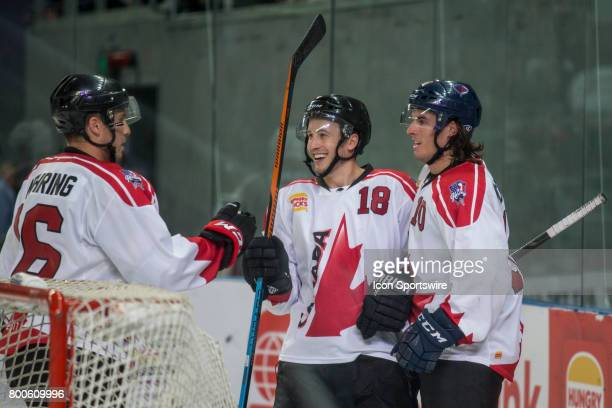 Steve McParland of Team Canada Chad Nehring of Team Canada and Adam Hughesman of Team Canada celebrate a Team Canada Goal during the Melbourne Game...