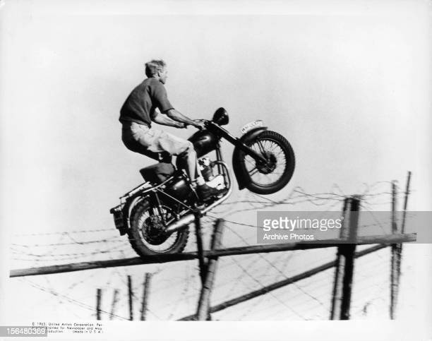 Steve McQueen flying through the sky on motorcycle in a scene from the film 'The Great Escape' 1963