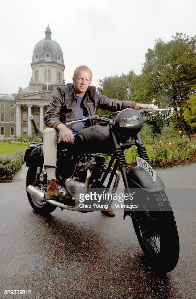 Steve McQueen lookalike Mark Myers poses with a replica of the 1961 Triumph 650cc motorcycle used in the film 'The Great Escape' outside the Imperial...