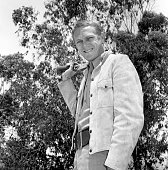 Steve McQueen of the CBS television western 'Wanted Dead or Alive' at CBS Television City Hollywood CA with his sawedoff carbine shotgun called...