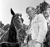 Steve McQueen of the CBS television western 'Wanted Dead or Alive' at CBS Television City Hollywood CA with his horse Image dated May 24 1960