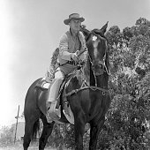 Steve McQueen of the CBS television western 'Wanted Dead or Alive' at CBS Television City Hollywood CA with his horse and his sawedoff carbine...