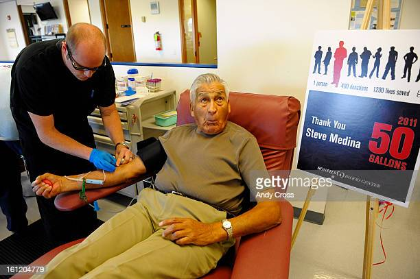 GOLDEN CO Steve Medina 85yearsold from Lakewood Colorado right reacts as Bonfils Blood Center apheresis tech Derek Heyl puts a needle in Medina's arm...