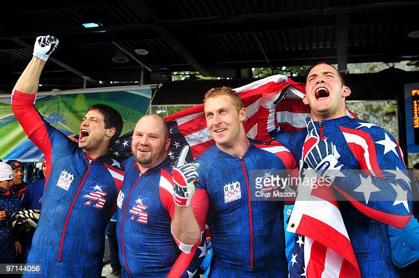 Steve Mesler Steven Holcomb Curtis Tomasevicz and Justin Olsen USA 1 celebrate after winning the gold medal during the men's four man bobsleigh on...