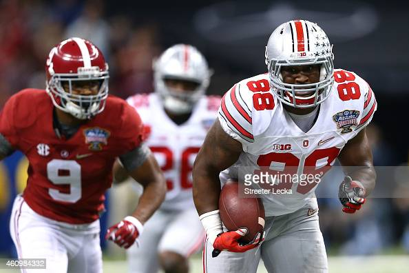 Steve Miller of the Ohio State Buckeyes scores a 41 yard interception return from Blake Sims of the Alabama Crimson Tide in the third quarter during...