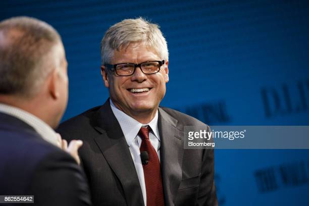 Steve Mollenkopf chief executive officer of Qualcomm Inc smiles during the Wall Street Journal DLive global technology conference in Laguna Beach...