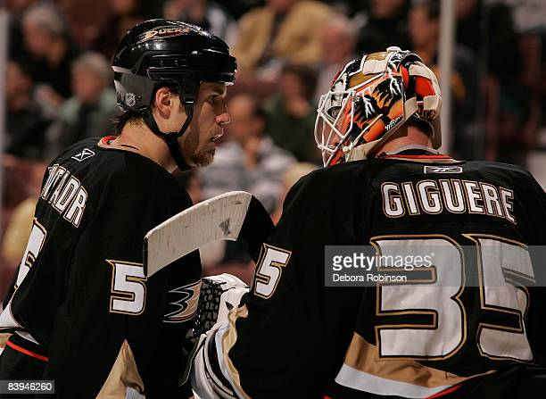 Steve Montador and JeanSebastien Giguere of the Anaheim Ducks talk on the ice during the game against the Columbus Blue Jackets on December 7 2008 at...