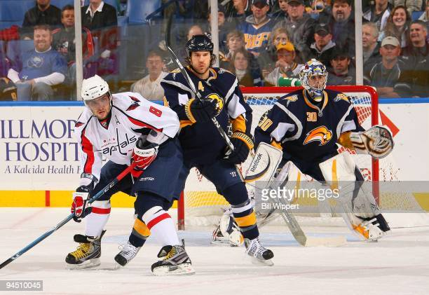 Steve Montador and Ryan Miller of the Buffalo Sabres defend against Alex Ovechkin of the Washington Capitals on December 9 2009 at HSBC Arena in...