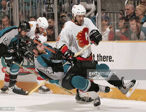 Steve Montador of Calgary Flames takes down Niko Dimitrakos of the San Jose Sharks during Game one of the 2004 NHL Western Conference Finals May 9...