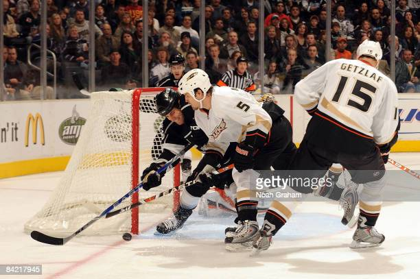 Steve Montador of the Anaheim Ducks fight for the puck outside the net against Jarret Stoll of the Los Angeles Kings during the game on January 8...