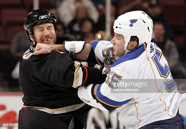 Steve Montador of the Anaheim Ducks mixes it up with Cam Janssen of the St Louis Blues during the game on November 5 2008 at Honda Center in Anaheim...
