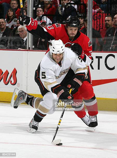 Steve Montador of the Anaheim Ducks stickhandles the puck as Jarkko Ruutu of the Ottawa Senators battles for position at Scotiabank Place on October...