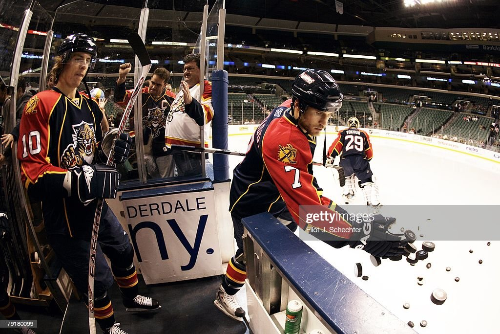 Steve Montador #7 of the Florida Panthers knocks practice pucks onto the ice prior to the start of the game against the Ottawa Senators at the Bank Atlantic Center on January 22, 2008 in Sunrise, Florida.