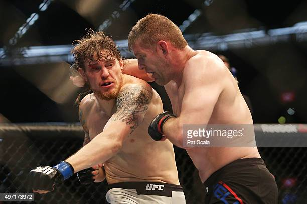 Steve Montgomery of the United States and Daniel Kelly of Australia compete in their middleweight bout during the UFC 193 event at Etihad Stadium on...