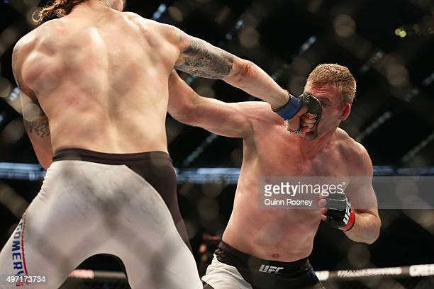 Steve Montgomery of the United States punches Daniel Kelly of Australia in their middleweight bout during the UFC 193 event at Etihad Stadium on...