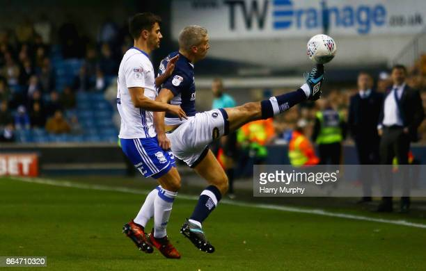 Steve Morison of Millwall attempts to control the ball under pressure from Maxime Colin of Birmingham City during the Sky Bet Championship match...