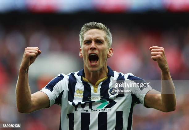 Steve Morison of Millwall celebrates victory and promotion after the Sky Bet League One Playoff Final between Bradford City and Millwall at Wembley...