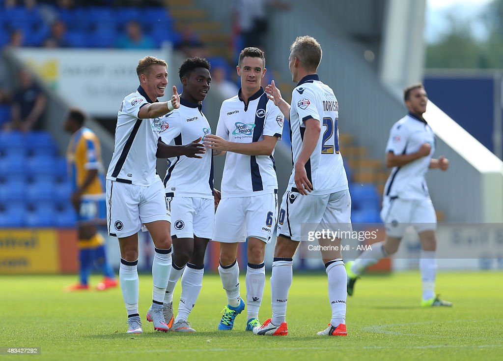 <a gi-track='captionPersonalityLinkClicked' href=/galleries/search?phrase=Steve+Morison+-+Voetballer&family=editorial&specificpeople=5483951 ng-click='$event.stopPropagation()'>Steve Morison</a> of Millwall celebrates with team mates <a gi-track='captionPersonalityLinkClicked' href=/galleries/search?phrase=Lee+Martin+-+Soccer+Player+-+Born+1987&family=editorial&specificpeople=15382346 ng-click='$event.stopPropagation()'>Lee Martin</a>, Fred Onyedinma and Shaun Williams of Millwall after scoring to make it 1-1 during the Sky Bet League One match between Shrewsbury Town and Millwall at Greenhous Meadow on August 8, 2015 in Shrewsbury, England.