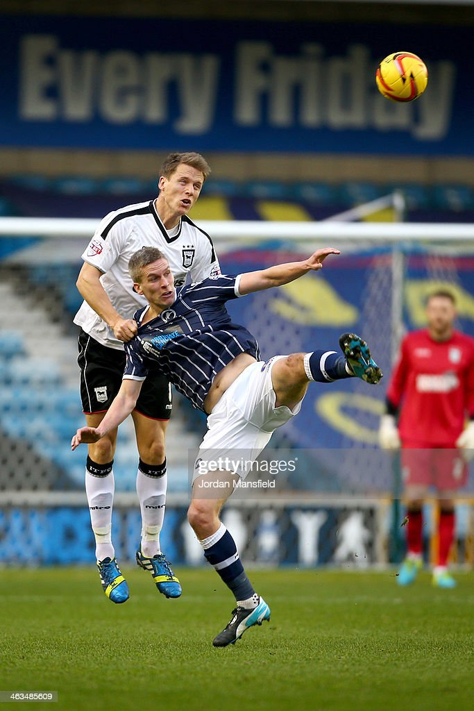Steve Morison of Millwall FC chasllenges to head the ball with Christophe Berra of Ipswich Town during the Sky Bet Championship match between Millwall and Ipswich Town at The Den on January 18, 2014 in London, England,