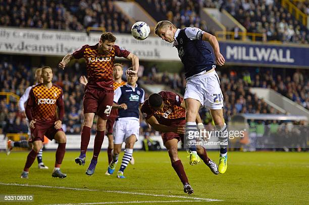 Steve Morison of Millwall FC has a header on goal during the Sky Bet League One Play Off Second Leg between Millwall and Bradford City at The Den on...