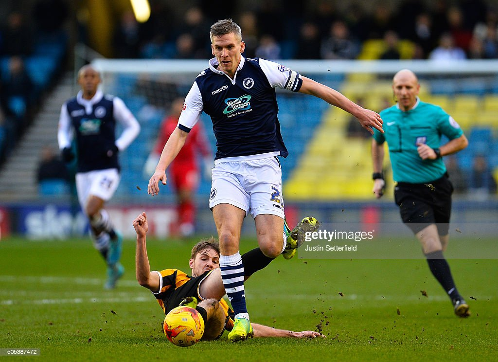 <a gi-track='captionPersonalityLinkClicked' href=/galleries/search?phrase=Steve+Morison+-+Voetballer&family=editorial&specificpeople=5483951 ng-click='$event.stopPropagation()'>Steve Morison</a> of Millwall FC is tackled by Sam Foley of Port Vale during the Sky Bet League One match between Millwall and Port Vale on January 17, 2016 in London, England.
