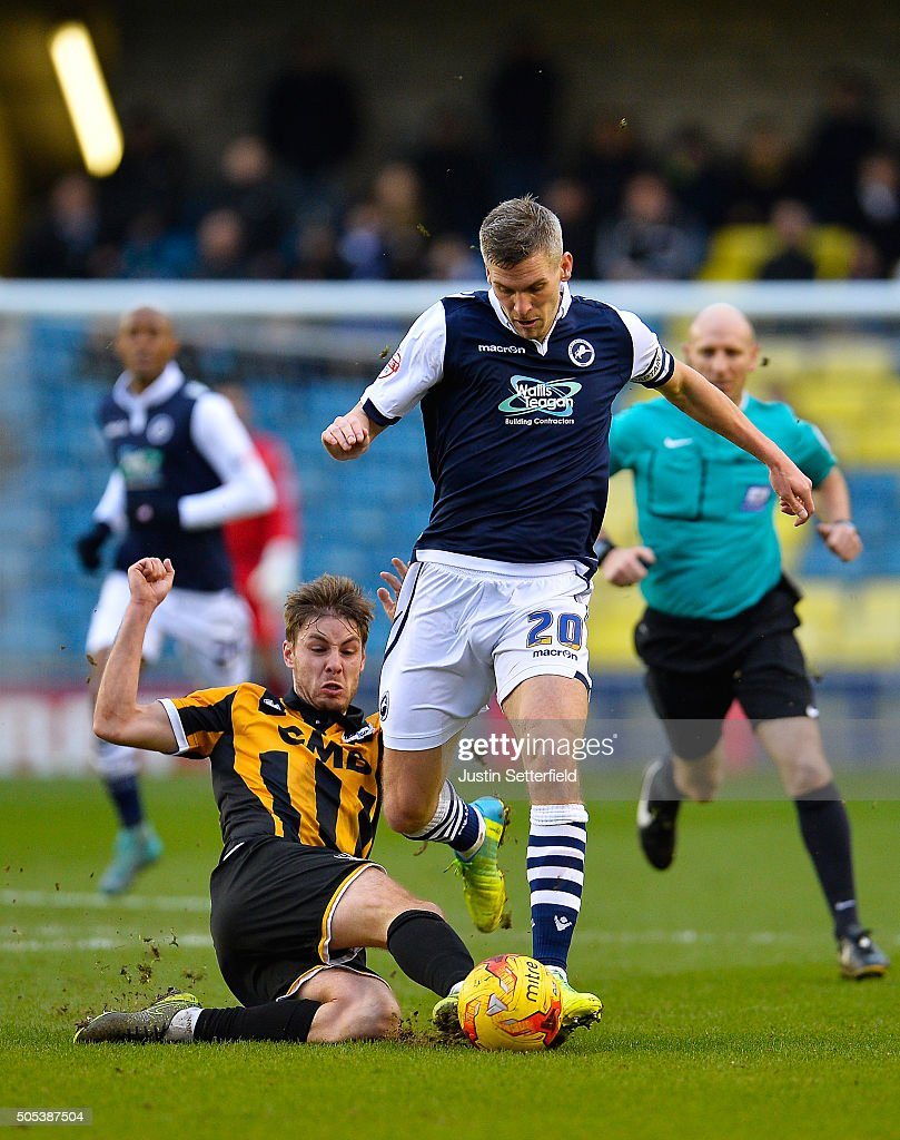Steve Morison of Millwall FC is tackled by Sam Foley of Port Vale during the Sky Bet League One match between Millwall and Port Vale on January 17, 2016 in London, England.