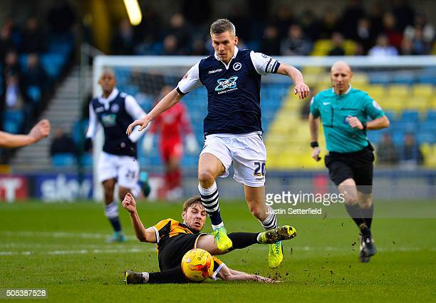 Steve Morison of Millwall FC is tackled by Sam Foley of Port Vale during the Sky Bet League One match between Millwall and Port Vale on January 17...