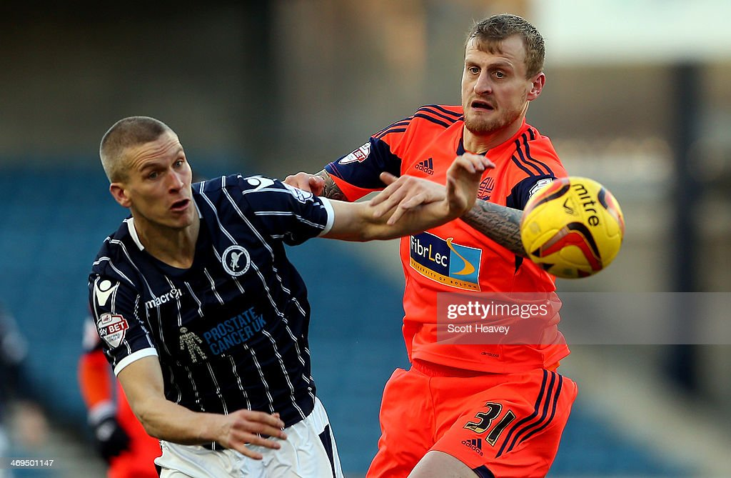 Steve Morison of Millwall (L) in action with David Wheater of Bolton during the Sky Bet Championship match between Millwall and Bolton Wanderers at The Den on February 15, 2014 in London, England.