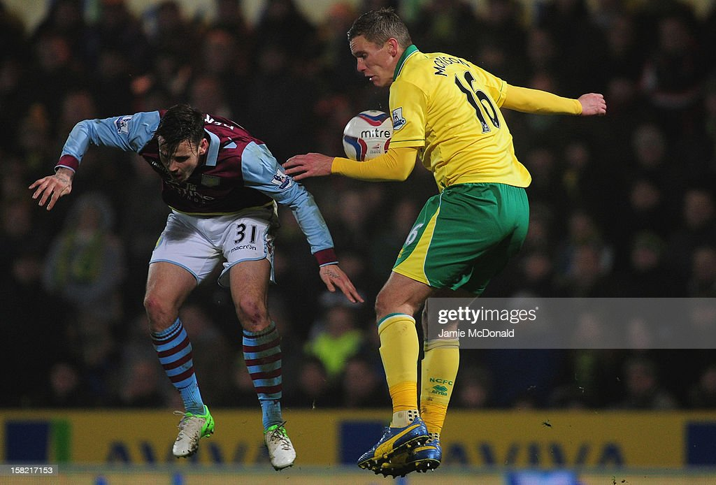 <a gi-track='captionPersonalityLinkClicked' href=/galleries/search?phrase=Steve+Morison+-+Voetballer&family=editorial&specificpeople=5483951 ng-click='$event.stopPropagation()'>Steve Morison</a> of Norwich City jumps with Chris Herd of Aston Villa during the Capital One Cup Quarter-Final match between Norwich City and Aston Villa at Carrow Road on December 11, 2012 in Norwich, England.