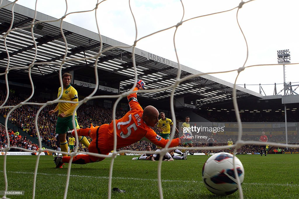 Steve Morison of Norwich City scores his teams first goal as goalkeeper Pepe Reina of Liverpool fails to save during the Barclays Premier League match between Norwich City and Liverpool at Carrow Road on September 29, 2012 in Norwich, England.