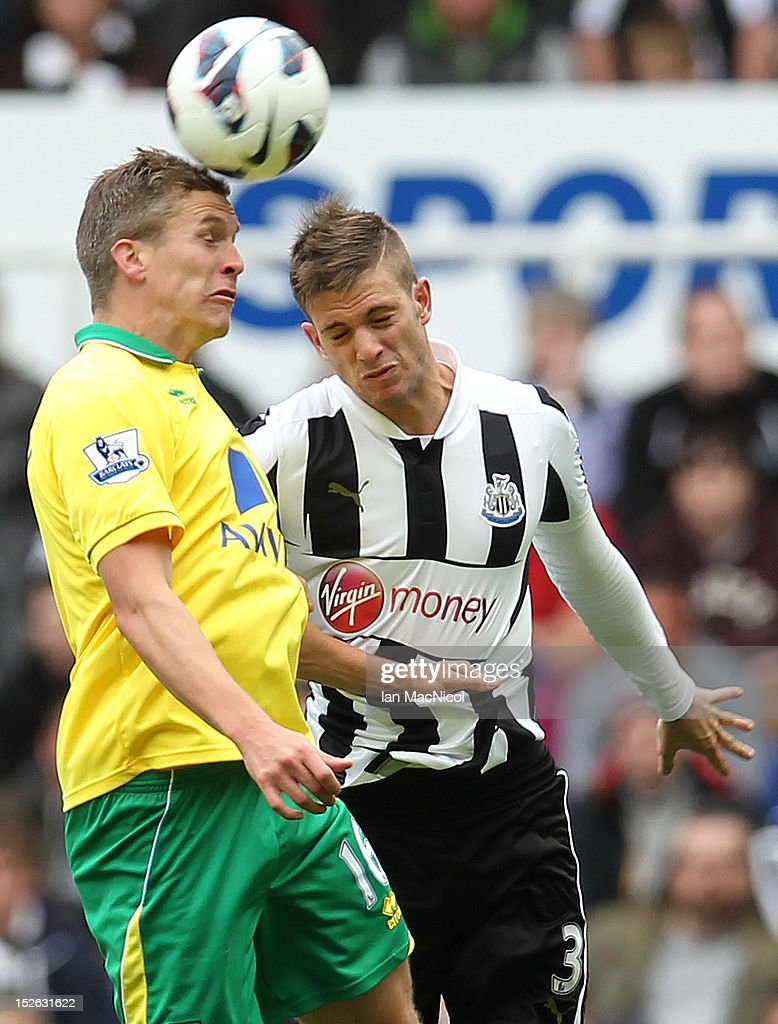 Steve Morrison (L) of Norwich City competes with Davide Santon of Newcastle United during the Barclays Premier League match between Newcastle United and Norwich City on September 23, 2012 in Newcastle, England.